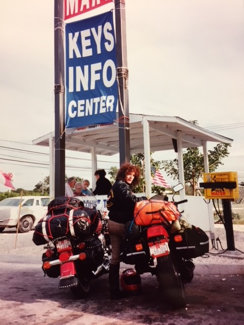 Ann Ferrar with her fully-loaded Honda Hawk GT650 on a trip to the Florida Keys after Daytona Bike Week, 1993. Ann rode all the way down I-95 from New York to Florida and back in the dead of winter that year. Daytona was just one stop among Ann's many long-distance road trips for her work on the original edition of <i>Hear Me Roar</i>, first published in 1996.