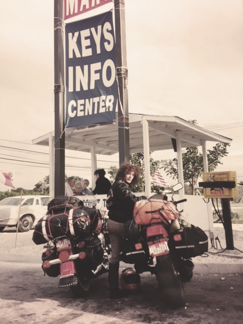 Ann Ferrar with her fully loaded Honda Hawk GT650 on a trip to the Florida Keys after Daytona Bike Week, 1993. This was one stop among many during Ann's long-distance road trips for <em>Hear Me Roar.</em>