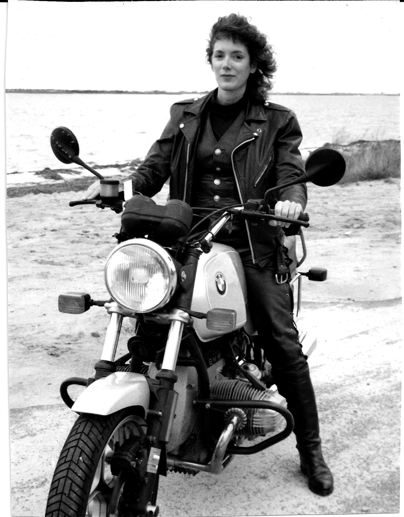 Ann Ferrar on her vintage BMW-R65 upon the 1996 release of the first edition of <em>Hear Me Roar</em>.
